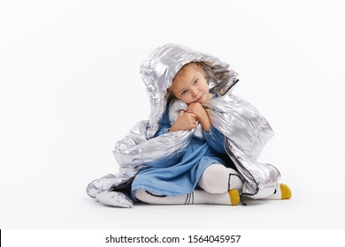 Child is pretending to be adults, dressed hher mother clothes, large size. measures a silver big jacket. Misses mom and measures her clothes. White background