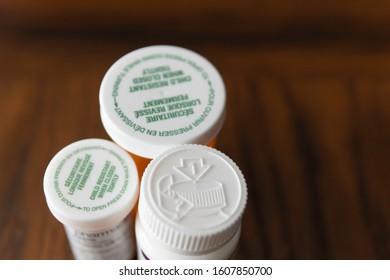 Child proof cover on prescription medicine bottles