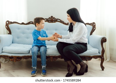 Child psychologist attending small boy. The concept of psychological assistance to children.