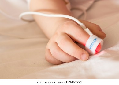 Child with a pulse oximeter on her finger