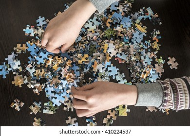 Child and puzzle.