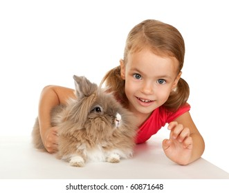 Child with a rabbit. In the Oriental calendar 2011 - the year of rabbit.