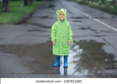 child in a raincoat autumn / autumn view a small child in a raincoat, a park in the city