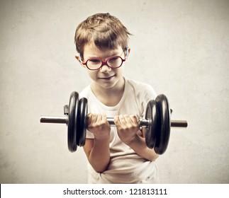 Child raising a dumbbell