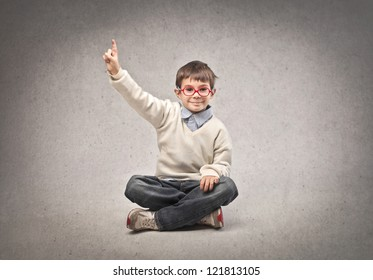 Child raising his right hand
