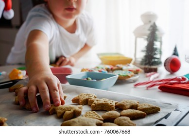 child reaching for cookie