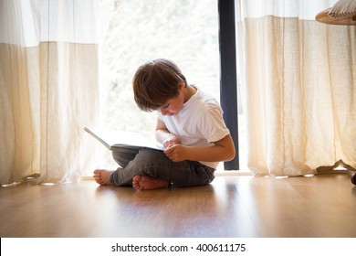 child reading a book at home