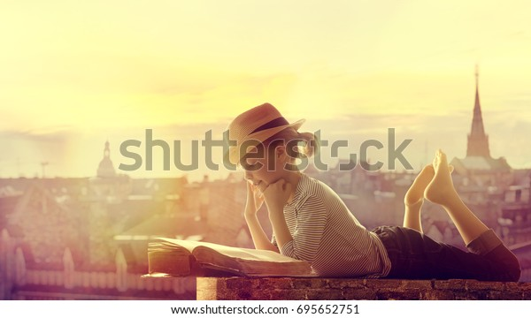 Child Reading Book Outdoor City Roof, Happy Girl Kid Read and Dream Children Books
