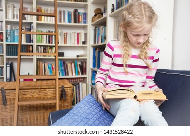 child reading a book at the private library