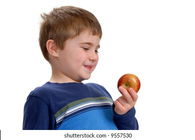 Child ready to eat an apple, isolated on white