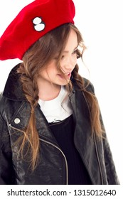 The child in the red beret and jacket is smiling happily and cheerfully. Portrait.