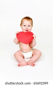 Child with red heart in hands on a white background