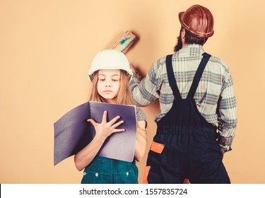 Child renovation room. Family remodeling house. Little fathers helper. Father bearded man and daughter hard hat helmet uniform renovating home. Home improvement activity. Kid girl planning renovation.
