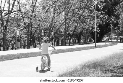 Child riding a bicycle in the park