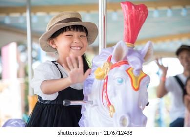 A child riding a merry-go-round