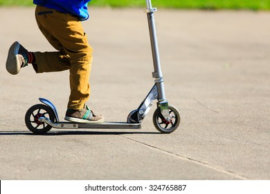 child riding scooter outdoors, active sport kids