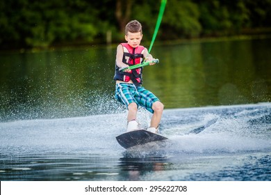 A child riding in the Wakeboarding