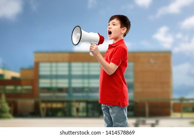 child rights, announcement and people concept - nice little boy in red polo shouting to megaphone over school background