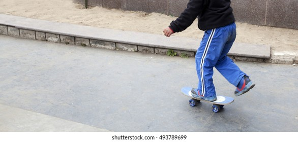 A child roller skating in road