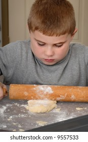 Child rolling out dough with rolling pin