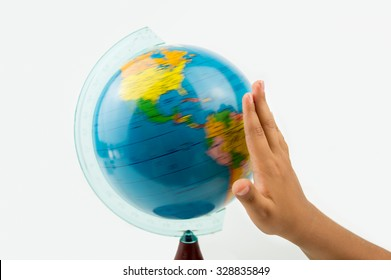 child rotating the globe with the hand