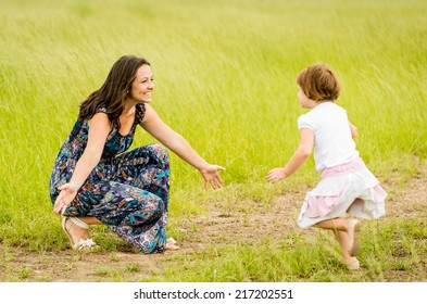 Child running to mother who is waiting with open arms