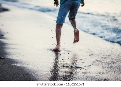 child running on the beach