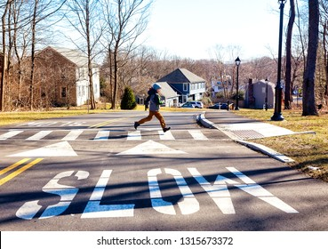Child running on crosswalk. boy runs across the road in front of the car