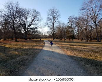 child running on gravel path