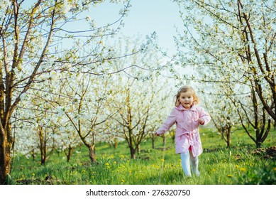 child running outdoors blossom trees. Art processing and retouching photos special.