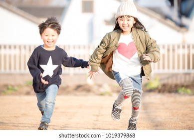 A child running with a smile