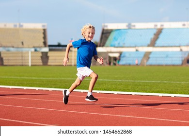 Child running in stadium. Kids run on outdoor track. Healthy sport activity for children. Little boy at athletics competition race. Young athlete training. Runner exercising. Jogging for kid.