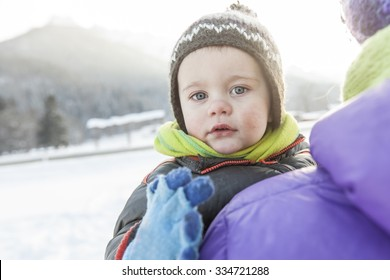 Child with runny nose in winter. Nasal congestion, common cold, runny nose, winter nuances concept.