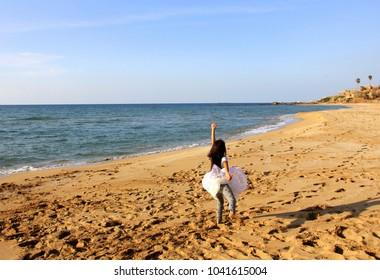 child runs along the beach