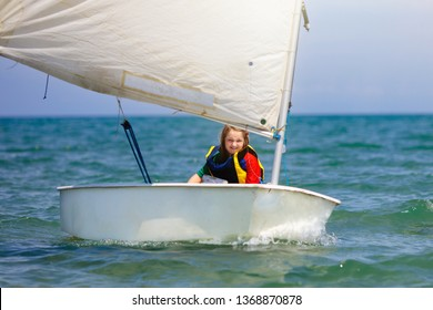 Child sailing. Kid learning to sail on sea yacht. Healthy water sport for school kids. Yachting class for young sailor. Children on boat.