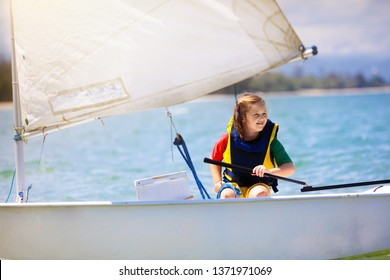 Child sailing. Kid learning to sail on sea yacht. Healthy water sport for school kids. Yachting class for young sailor. Children on boat. Family summer vacation on tropical island. Beach activity.