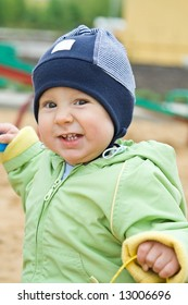 Child in a sandbox close-up
