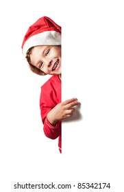 Child as Santa Claus holding a white blank sign