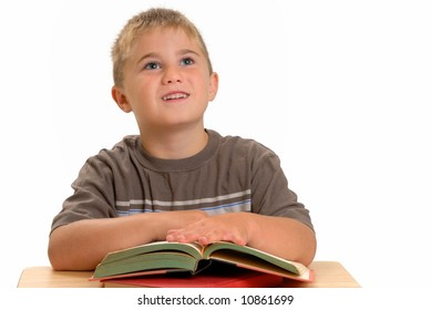 Child at school desk with books