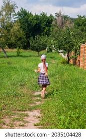 Child schooler with smartwatch running outdoor park. Kid using smartwatches active lifestyle sport. Schoolgirl searching in internet watches touchscreen display. Smart wristwatch pedometer GPS tracker