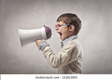 Child screaming into a megaphone