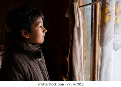 a child sees his future through a window