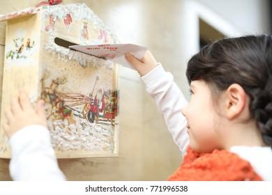 Child sending the letter for Santa Claus