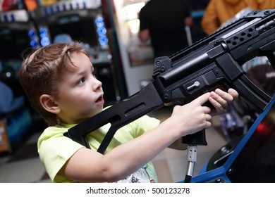 Child shooting a rifle in an amusement park