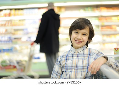 Child shopping in supermarket