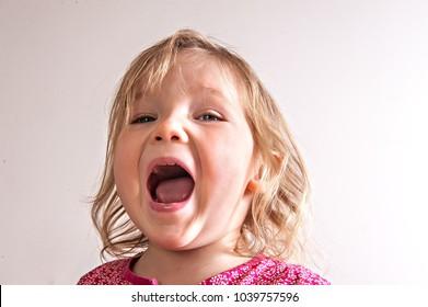Child Shouting. Angry girl