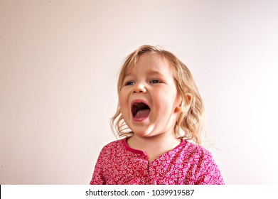 Child Shouting. Angry girl