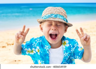 Child Shouts Laughs Hawaiian Shirt Straw Hat Holidays Clothes Isolated Natural Beach Sea Background