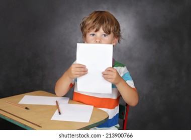 Child showing blank page, learning, school or education concept