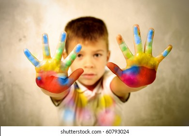 Child showing his colored hands